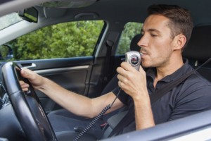 Man blowing into ignition interlock